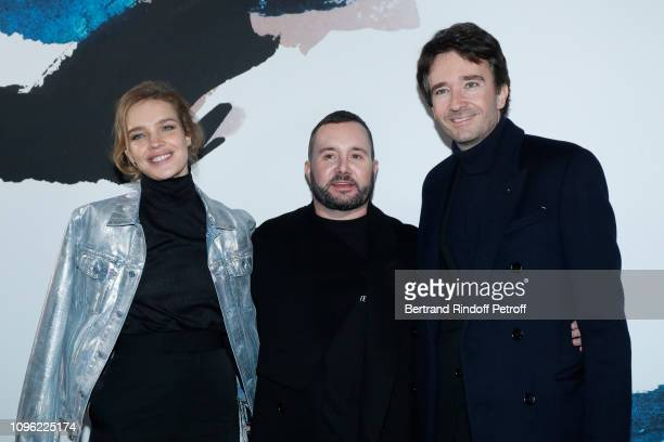 Stylist Kim Jones standing between General manager of Berluti Antoine Arnault and Natalia Vodianova pose after the Dior Homme Menswear Fall/Winter...