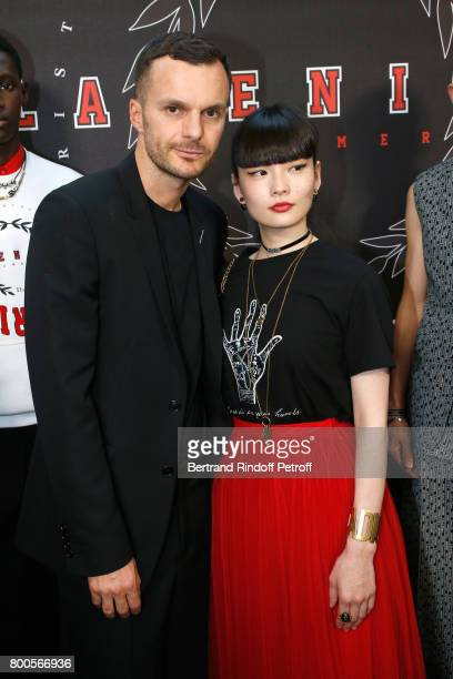 Stylist Kris Van Assche and Kozue Akimoto pose Backstage after the Dior Homme Menswear Spring/Summer 2018 show as part of Paris Fashion Week on June...