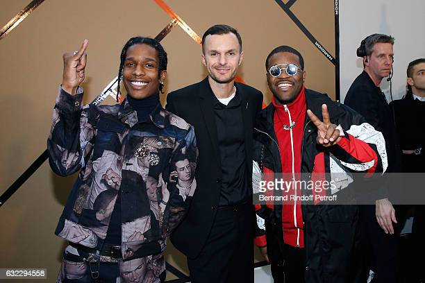 Asap ferg pictures and photos getty images stylist kris van assche standing between rappers asap ferg asap rocky pose backstage after the dior m4hsunfo