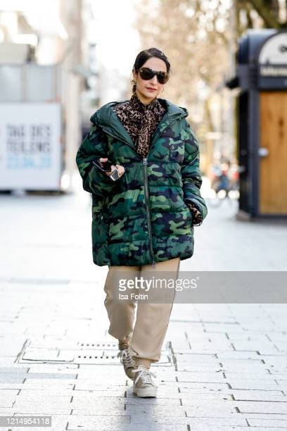 Stylist Laila Hamidi wearing a jacket with camouflage pattern by GlamOMeter beige pants by Zara beige sneakers by Vai Vai a brown blouse with leopard...
