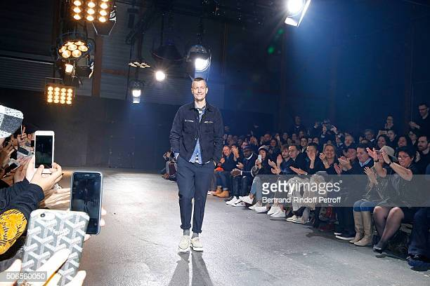 Stylist Lucas Ossendrijver acknowledges the applause of the audience at the end of the Lanvin Menswear Fall/Winter 2016-2017 show as part of Paris...