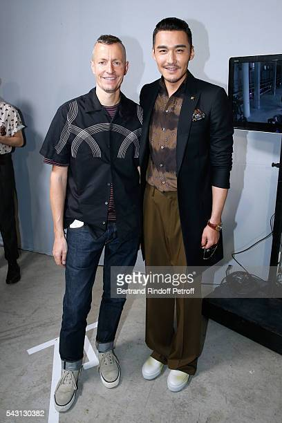 Stylist Lucas Ossendrijver and actor Bing Hu attends the Lanvin Menswear Spring/Summer 2017 show as part of Paris Fashion Week on June 26, 2016 in...