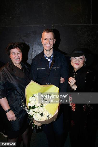 Stylist Lucas Ossendrijver standing between General Director of Lanvin Michele Huiban and Owner of Lanvin Shaw Lan Wang attend the Lanvin Menswear...