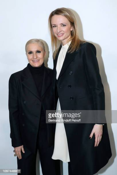 Stylist Maria Grazia Chiuri and Louis Vuitton's executive vice president Delphine Arnault pose after the Christian Dior Haute Couture Spring Summer...