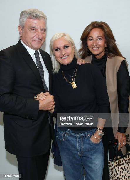 Stylist Maria Grazia Chiuri standing between Chief Executive Officer of LVMH Fashion Group Sidney Toledano and his wife Katia Toledano pose after the...