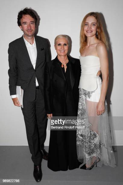 Stylist Maria Grazia Chiuri standing between General manager of Berluti Antoine Arnault and Natalia Vodianova pose after the Christian Dior Haute...