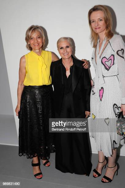 Stylist Maria Grazia Chiuri standing between Louis Vuitton's executive vice president Delphine Arnault and her mother Helene Arnault pose after the...