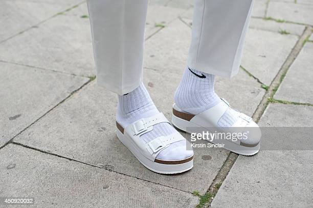 Stylist Marvin Maddix wears Topshop trousers and shoes Nike socks on day 2 of London Collections Men on June 16 2014 in London England