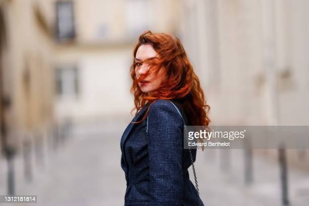 Stylist Nastasia Iavorscaia @a.la.rousse , a navy blue wool blazer checkered jacket from Maje, on April 11, 2021 in Paris, France.