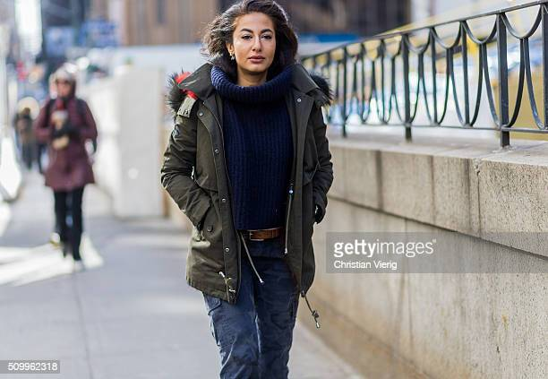 Stylist Nausheen Shah wearing a green parka jacket a blue turtleneck sweater and blue military pants seen outside BCBG Max Azria during New York...