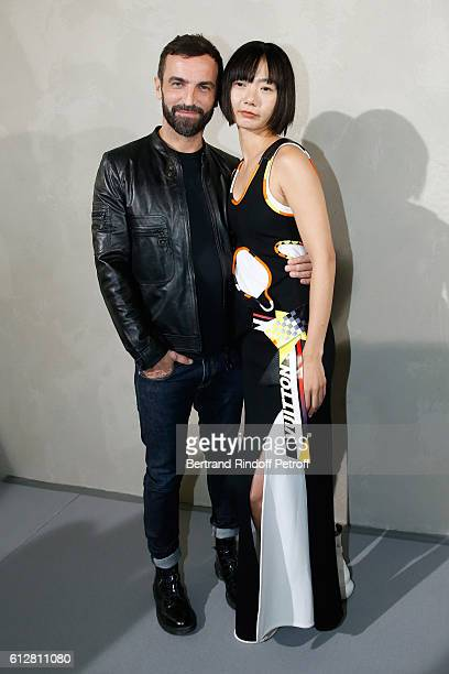Stylist Nicolas Ghesquiere and actress Doona Bae pose after the Louis Vuitton show as part of the Paris Fashion Week Womenswear Spring/Summer 2017 on...