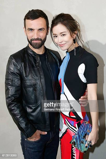 Stylist Nicolas Ghesquiere and actress Janice Man pose after the Louis Vuitton show as part of the Paris Fashion Week Womenswear Spring/Summer 2017...
