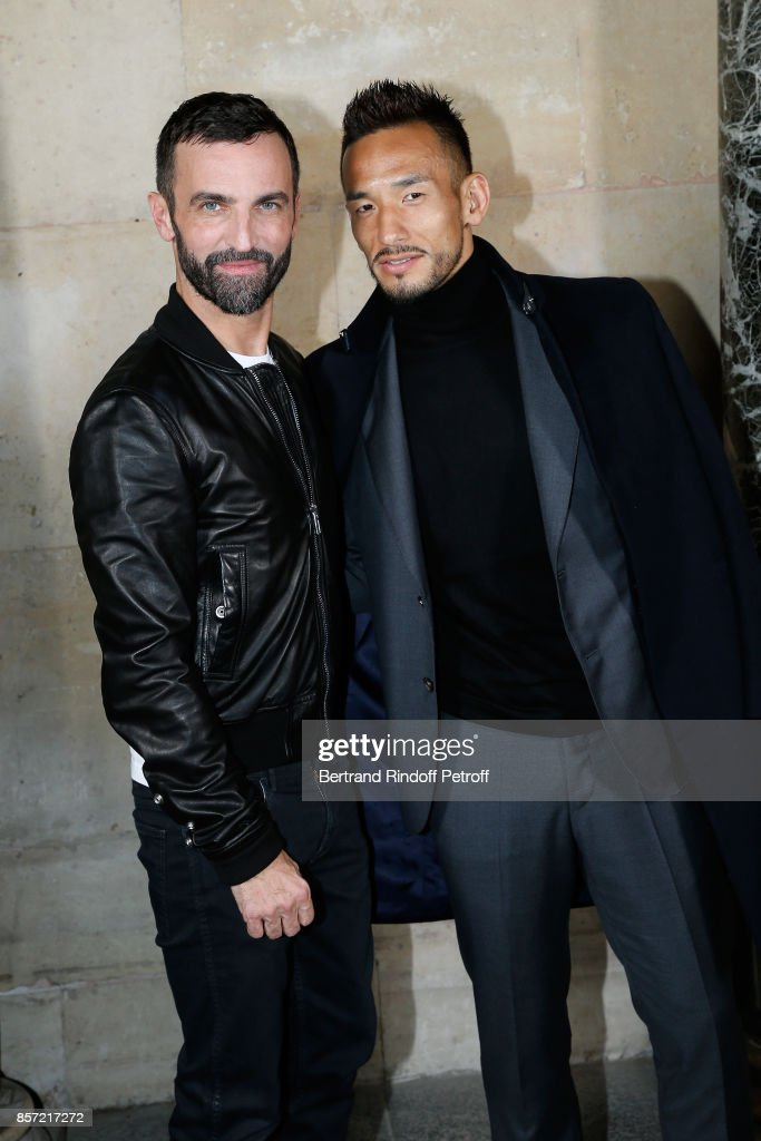 Stylist Nicolas Ghesquiere and Hidetoshi Nakata pose after the Louis Vuitton show as part of the Paris Fashion Week Womenswear Spring/Summer 2018 on October 3, 2017 in Paris, France.