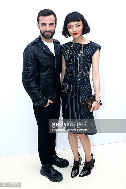 Stylist Nicolas Ghesquiere and Rila Fukushima pose backstage after the Louis Vuitton show as part of the Paris Fashion Week Womenswear Fall/Winter...