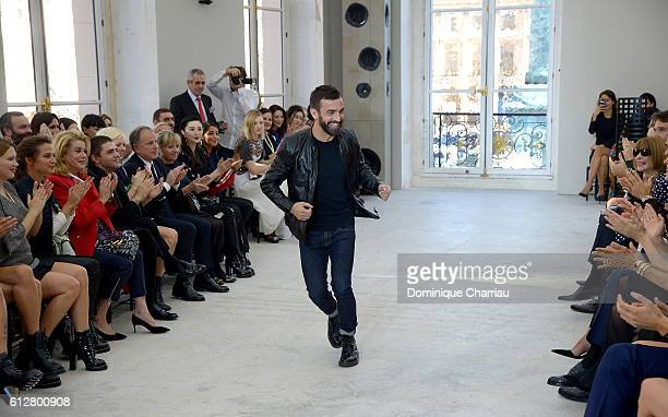 Stylist Nicolas Ghesquiere arrives on the runway at the end of the Louis Vuitton show as part of the Paris Fashion Week Womenswear Spring/Summer 2017...