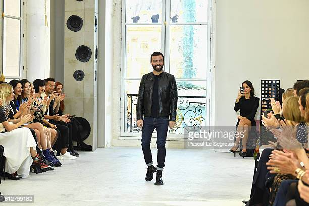 Stylist Nicolas Ghesquiere arrives on the runwayat the end of the show during the Louis Vuitton show as part of the Paris Fashion Week Womenswear...