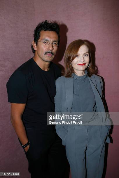 Stylist of Berluti men Haider Ackermann and Actress Isabelle Huppert pose after the Berluti Menswear Fall/Winter 20182019 show as part of Paris...