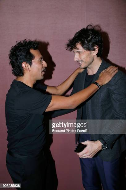 Stylist of Berluti men Haider Ackermann and model Andres Velencoso pose after the Berluti Menswear Fall/Winter 20182019 show as part of Paris Fashion...