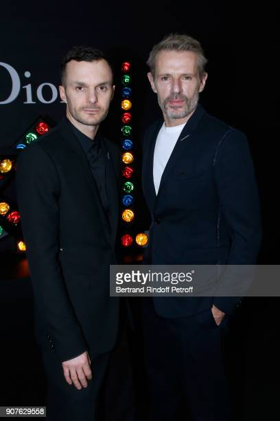 Stylist of Dior Men Kris Van Assche and actor Lambert Wilson pose after the Dior Homme Menswear Fall/Winter 20182019 show as part of Paris Fashion...