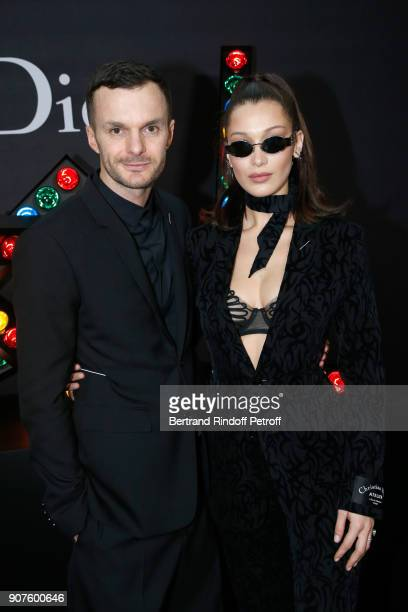 Stylist of Dior Men Kris Van Assche and model Bella Hadid pose after the Dior Homme Menswear Fall/Winter 20182019 show as part of Paris Fashion Week...