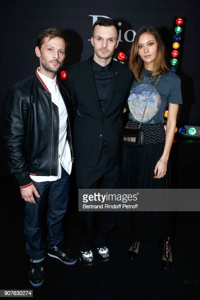 Stylist of Dior Men Kris Van Assche standing between Nicolas Duvauchelle and Anouchka Alsif pose after the Dior Homme Menswear Fall/Winter 20182019...