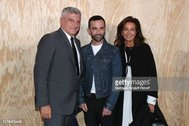 Stylist of Vuitton Nicolas Ghesquiere standing between Chief Executive Officer of LVMH Fashion Group Sidney Toledano and his wife Katia Toledano pose...