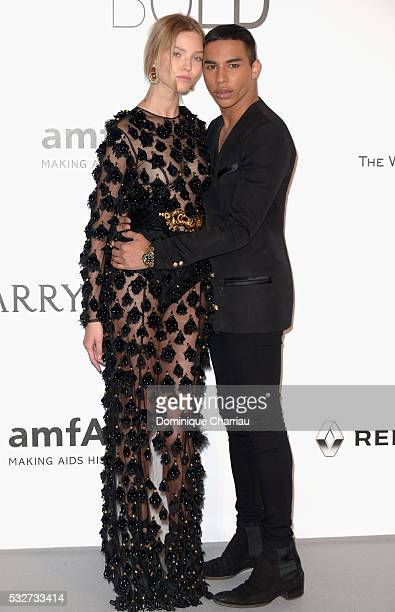Stylist Olivier Rousteing and model Sasha Luss attend the amfAR's 23rd Cinema Against AIDS Gala at Hotel du CapEdenRoc on May 19 2016 in Cap...
