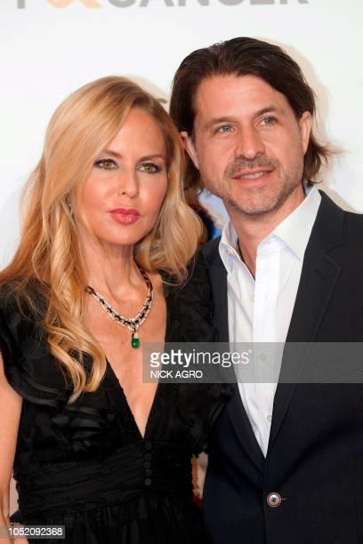 US stylist Rachel Zoe and husband Rodger Berman arrive for the F*ck Cancer Gala at Warner Bros Studio in Burbank California on October 13 2018