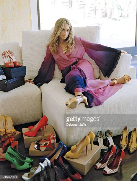 Stylist Rachel Zoe posing for In Style Magazine trying on shoes