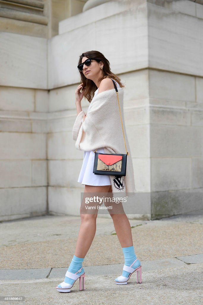 Stylist Renata Kharkova wears a Wild Fox Couture sweater and sunglasses, COS skirt, Celine bag and Aperlai shoes after Chanel show on July 8, 2014 in Paris, France.
