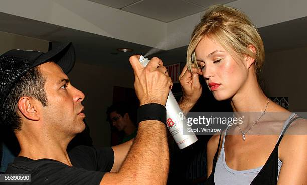Stylist Ricardo Rojas works with a model backstage at the Alvin Valley Spring 2006 fashion show during Olympus Fashion Week at W Hotel Union Square...