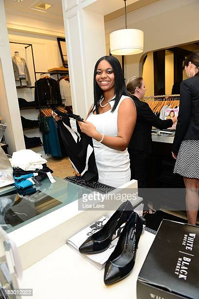 WHBM stylist rings up apparel for customer during Shop For A Cause with Living Beyond Breast Cancer and People StyleWatch hosted at White House/Black...