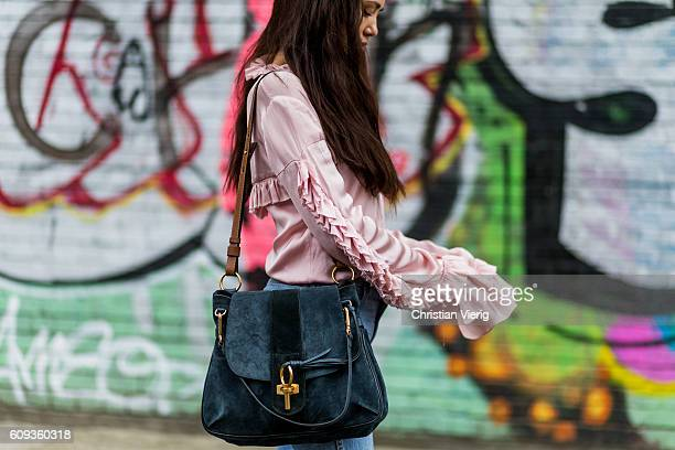 Stylist RosaSafiah Connell wearing a pink blouse and a Chloe Lexa bag outside Marques Almeida during London Fashion Week Spring/Summer collections...