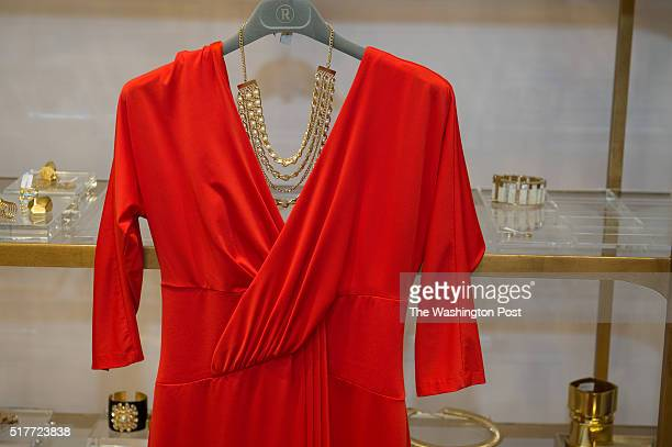 RUNWAY stylist Sankara XT McCain displays a client's dress choice complete with a necklace in Washington DC on December 12 2014 We explore the...