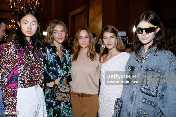 Stylist Stella McCartney Arizona Muse and Models pose Backstage after the Stella McCartney show as part of the Paris Fashion Week Womenswear...