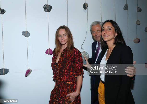 Stylist Stella McCartney Chairman of the Board of Galeries Lafayette Group Philippe Houze and Secretary of State to the Minister of the Ecological...