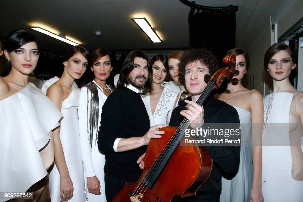 Stylist Stephane Rolland, Violoncellist Francois Salque and Models pose after the Stephane Rolland Haute Couture Spring Summer 2018 show as part of...