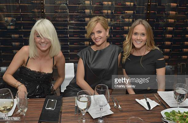 Stylist Taylor Jacobsen actress Mena Suvari and VP of Strategic Partnerships GenArt Katie May attend GenArt's 14th Annual Fresh Faces In Fashion...