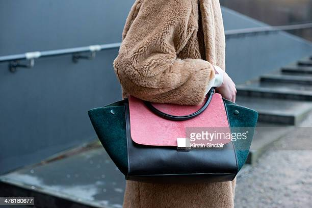 Stylist Tess Yopp wears a Celine bag Max Mara coat on day 5 of London Collections Women on February 18 2014 in London England