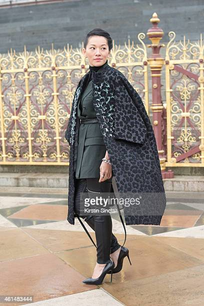 Stylist Tina Leung wearing a Louis Vuitton bag Giuseppe Zanotti shoes Dior jacket Dunhill Blazer and Maje trousers on day 4 of London Collections Men...