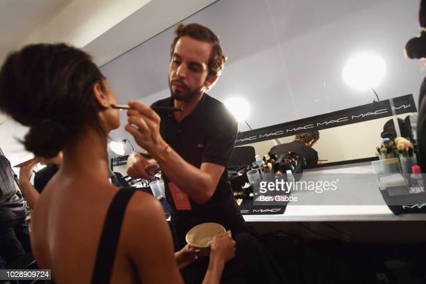 A stylist uses Mac makeup prodicts backstage at the Chromat show New York Fashion Week The Shows at Spring Studios on September 7 2018 in New York...