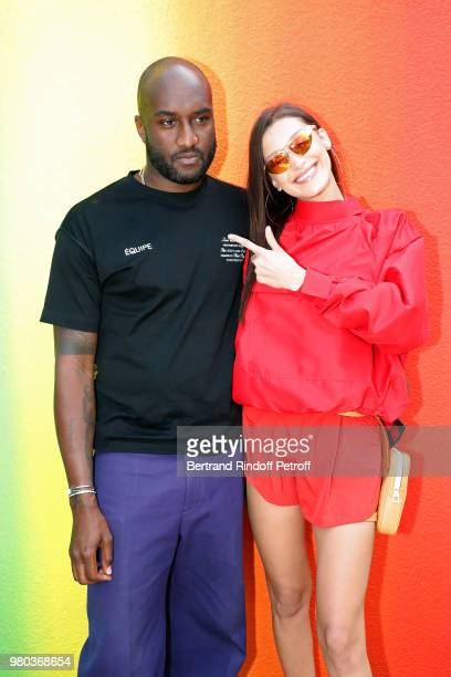 Stylist Virgil Abloh and Bella Hadid pose after the Louis Vuitton Menswear Spring/Summer 2019 show as part of Paris Fashion Week on June 21 2018 in...