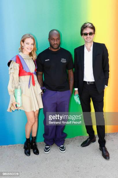 Stylist Virgil Abloh standing between Natalia Vodianova and General manager of Berluti Antoine Arnault pose after the Louis Vuitton Menswear...