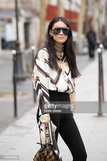 Stylist Writer Fashion DirectoratLarge for Hong Kong Tatler Justine Lee wears Loewe sunglasses Jimmy Choo bag and Peter Do shirt and trousers on...