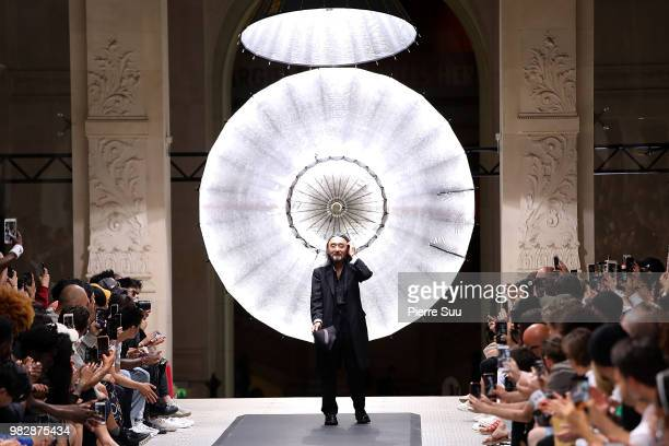 Stylist Yohji Yamamoto salutes the guests on the runway during the Y-3 Menswear Spring/Summer 2019 show as part of Paris Fashion Week on June 24,...