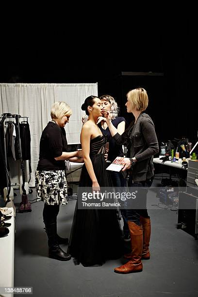 Stylists and model backstage at fashion show