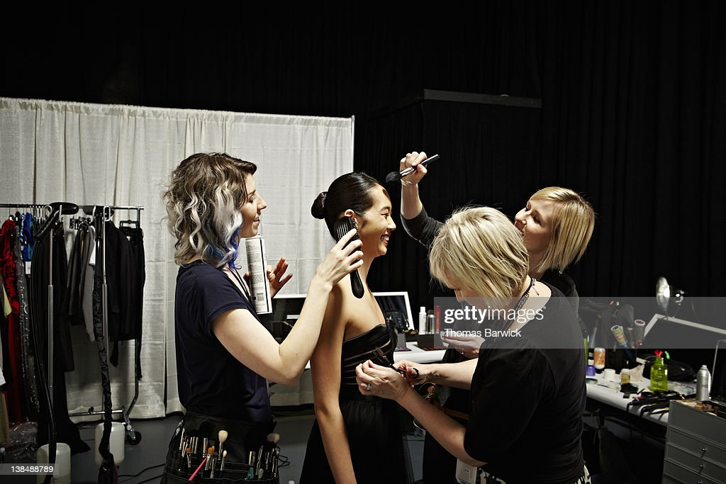 Stylists and model backstage at fashion show : Stock Photo