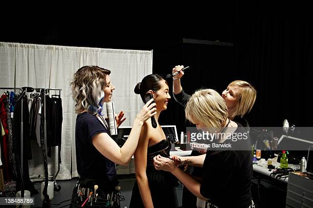 stylists and model backstage at fashion show - fashion show stock pictures, royalty-free photos & images