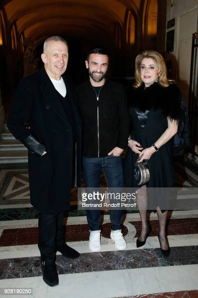 Stylists JeanPaul Gaultier Nicolas Ghesquiere and actress Catherine Deneuve pose after the Louis Vuitton show as part of the Paris Fashion Week...