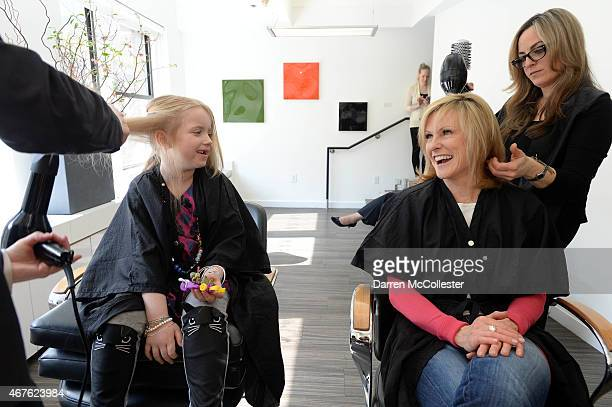 Stylists Jesse Blodgett and Rossana Casale give haircuts to Annika and WBZ anchor Lisa Hughes to kick off HAIRraising to support Boston Children's...